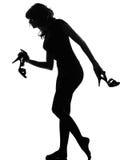De vrouw die van het silhouet vrij blootvoets op tiptoe loopt Stock Fotografie
