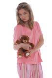 De vrouw die van Yonge een leuke teddybeer houdt Stock Foto