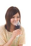 De vrouw die wijn drinkt Stock Fotografie