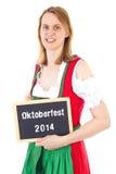 De vrouw in dirndl toont bord: Oktoberfest 2014 Royalty-vrije Stock Foto