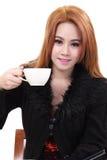De vrouw drinkt koffie Stock Fotografie
