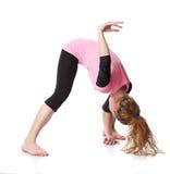 De vrouw is een acrobaat Stock Foto