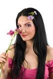 De vrouw en de bloem van de lente royalty-vrije stock afbeelding