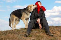 De vrouw en de hond Stock Afbeeldingen