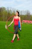 De vrouw gaat oefeningen, sportthema nemen Stock Foto