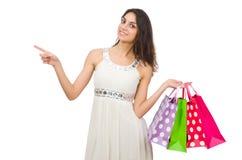 De vrouw in het winkelen concept op wit wordt geïsoleerd dat Stock Afbeeldingen