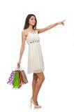 De vrouw in het winkelen concept op wit wordt geïsoleerd dat Stock Foto's