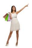 De vrouw in het winkelen concept op wit wordt geïsoleerd dat Royalty-vrije Stock Foto's