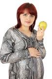 De vrouw houdt appel stock afbeelding