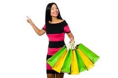 De vrouw in Kerstmis het winkelen concept op wit Stock Afbeeldingen