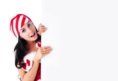 De vrouw kleedde zich als Kerstman Royalty-vrije Stock Foto