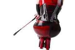 De vrouw kleedde zich in dominatrixkleren Royalty-vrije Stock Afbeelding
