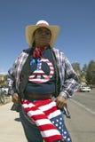 De vrouw met een vrede-Amerikaanse t-shirt protesteert President George W Bush in Tucson, AZ bij een politieke verzameling royalty-vrije stock foto's