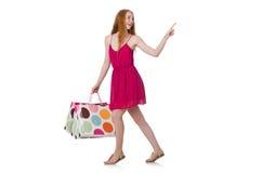 De vrouw met het winkelen zakken op wit Royalty-vrije Stock Foto