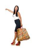 De vrouw met het winkelen zakken op wit Stock Fotografie