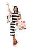 De vrouw met het winkelen zakken op wit Stock Afbeeldingen