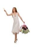 De vrouw met het winkelen zakken op wit wordt geïsoleerd dat Stock Fotografie