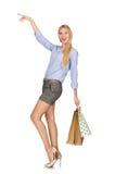 De vrouw met het winkelen zakken op wit wordt geïsoleerd dat Royalty-vrije Stock Afbeelding