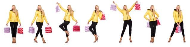 De vrouw met het winkelen zakken op wit wordt geïsoleerd dat Royalty-vrije Stock Foto's