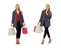 De vrouw met het winkelen zakken op wit wordt geïsoleerd dat Stock Foto's