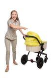 De vrouw met kinderwagen op wit wordt geïsoleerd dat royalty-vrije stock foto's