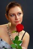 De vrouw met nam toe Royalty-vrije Stock Fotografie