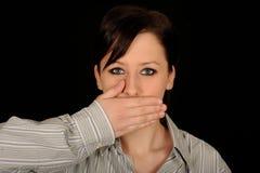 De vrouw met overhandigt mond royalty-vrije stock afbeeldingen