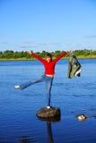 De vrouw op een steen Royalty-vrije Stock Fotografie