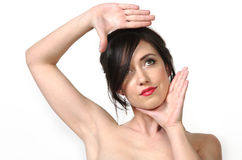 De vrouw overhandigt frame gezicht Royalty-vrije Stock Foto's
