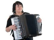 De vrouw speelt een harmonika stock foto