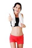 De vrouw in sport kleedt omhoog gesturing duimen Stock Afbeelding