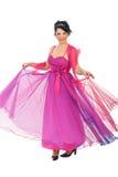 De vrouw tolde haar roze kleding Stock Fotografie