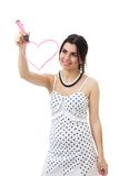 De vrouw trekt roze hart Stock Foto's