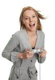 De vrouw van Beautilful jonge het spelen videospelletjes Royalty-vrije Stock Afbeeldingen
