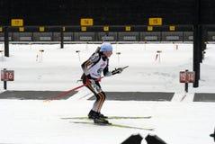 De vrouw van Biathlon stock afbeeldingen
