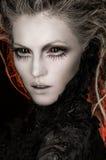 De vrouw van de blonde met creatieve make-up stock fotografie