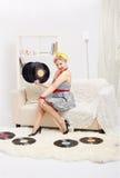 De vrouw van de blonde met vinyl Stock Afbeelding