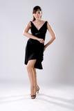 De vrouw van de elegantie in het dansen stelt stock fotografie