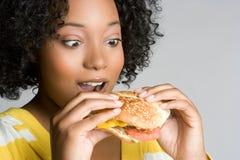 De Vrouw van de hamburger stock afbeelding