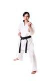 De vrouw van de karate het stellen stock fotografie