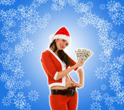 De vrouw van de kerstman met geld Royalty-vrije Stock Afbeelding