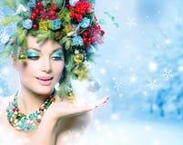 De Vrouw van de Kerstmiswinter Stock Foto