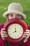 De Vrouw van de klok stock afbeelding