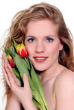 De vrouw van de lente met bloemen Stock Afbeeldingen