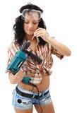 De vrouw van de reparatie met boor Stock Foto's