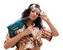 De vrouw van de reparatie met boor Stock Afbeeldingen