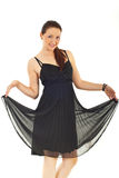 De vrouw van de schoonheid in elegante zwarte kleding stock afbeeldingen