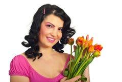 De vrouw van de schoonheid met tulpen Stock Afbeelding
