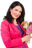 De vrouw van de schoonheidslente met bloemen Stock Fotografie