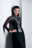 De vrouw van de sensualiteit in zwarte kleding Stock Afbeelding